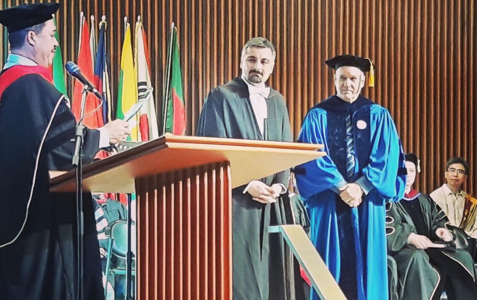 Giving the graduation talk at a graduate school in Manila