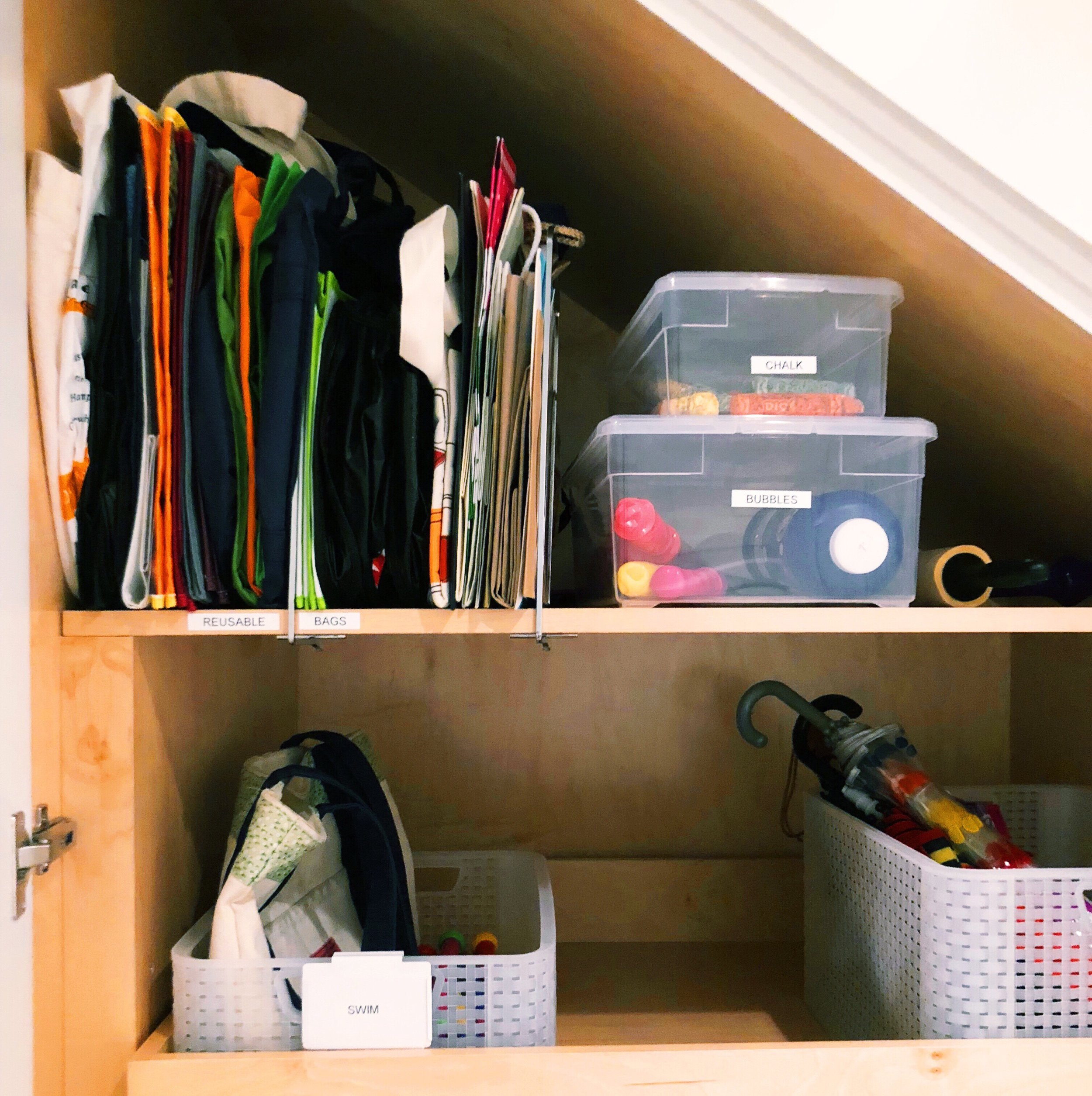 Henry & Higby Organizing Coat Closet.JPG