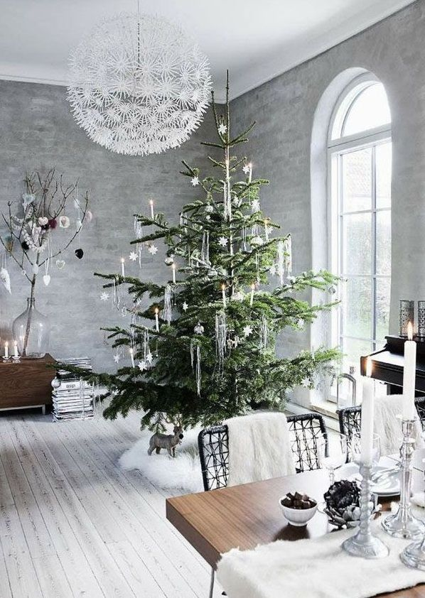 Try keeping your Christmas decorations in the same tone as your current home décor, but lift the existing palette with pops of fresh green or natural elements such as branches, pine cones etc. An abundance of warm glowing lights always adds a feeling of festive coziness – fairy lights can be used throughout the year in most other occasions so purchasing a few every now and then will help you to brighten up your home with an abundant glow over the Christmas period.