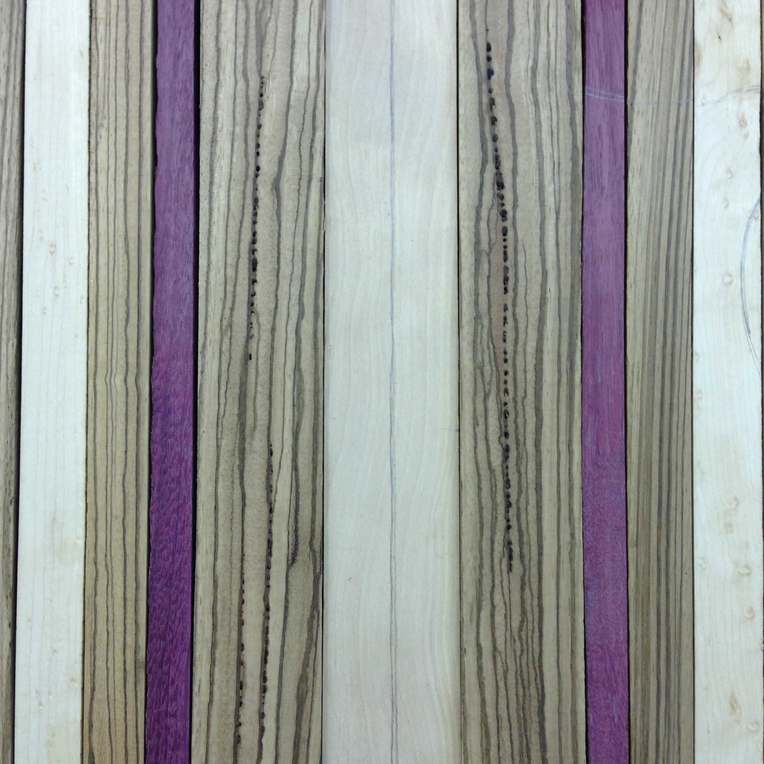 Some birdseye maple, purple heart and zebrawood glued together for a funky top.