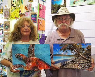 Dean and John display their popular metal prints at SugarBirds.