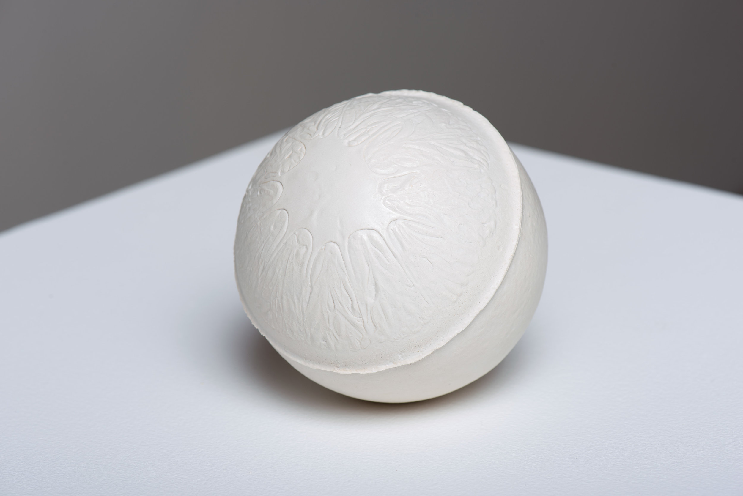 Navel , 2017 Gypsum cement, and porcelain dust 3 1/2 inches (round)