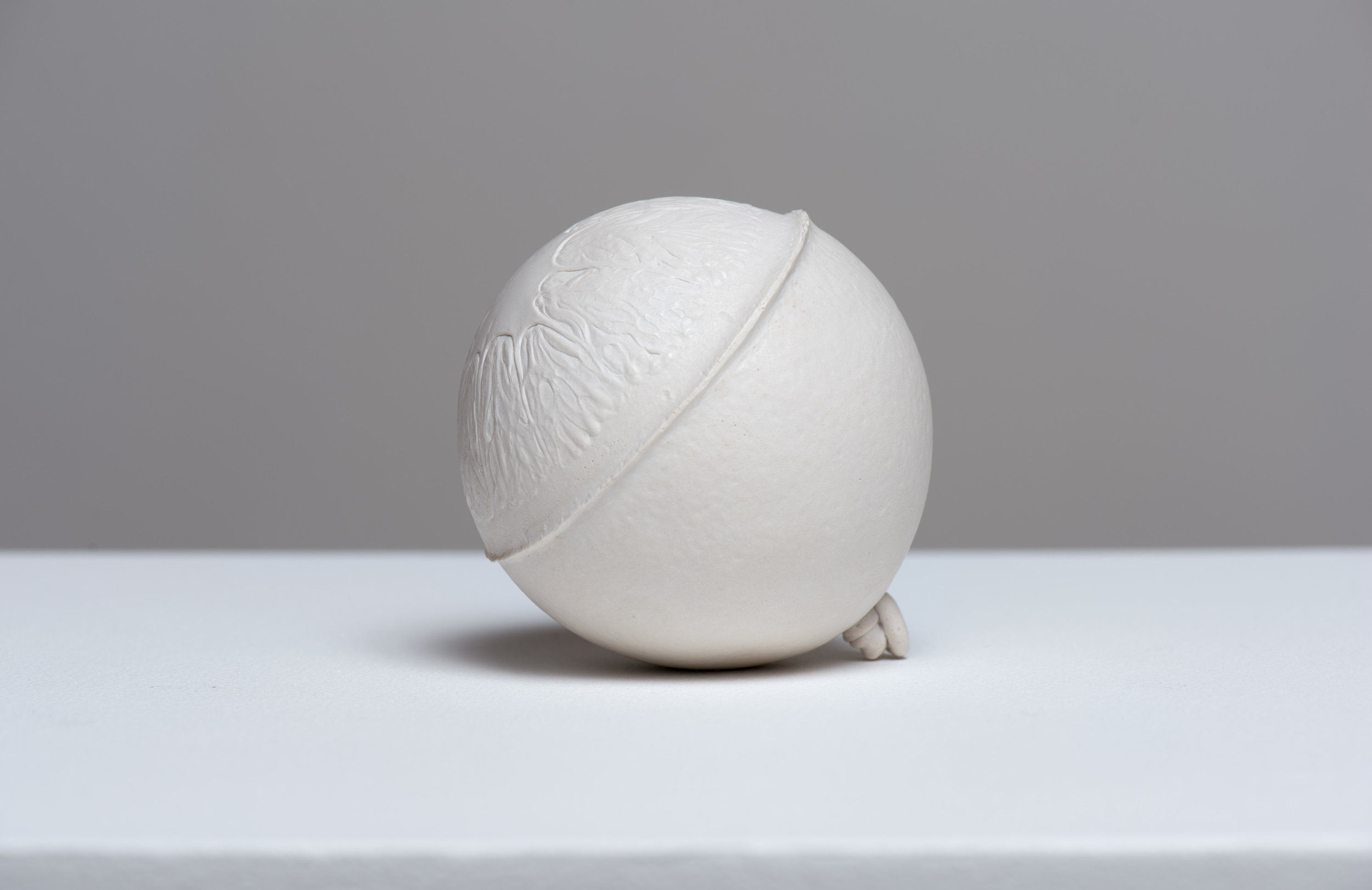 SIDE VIEW  Navel , 2017 Gypsum cement, and porcelain dust 3 1/2 inches (round)