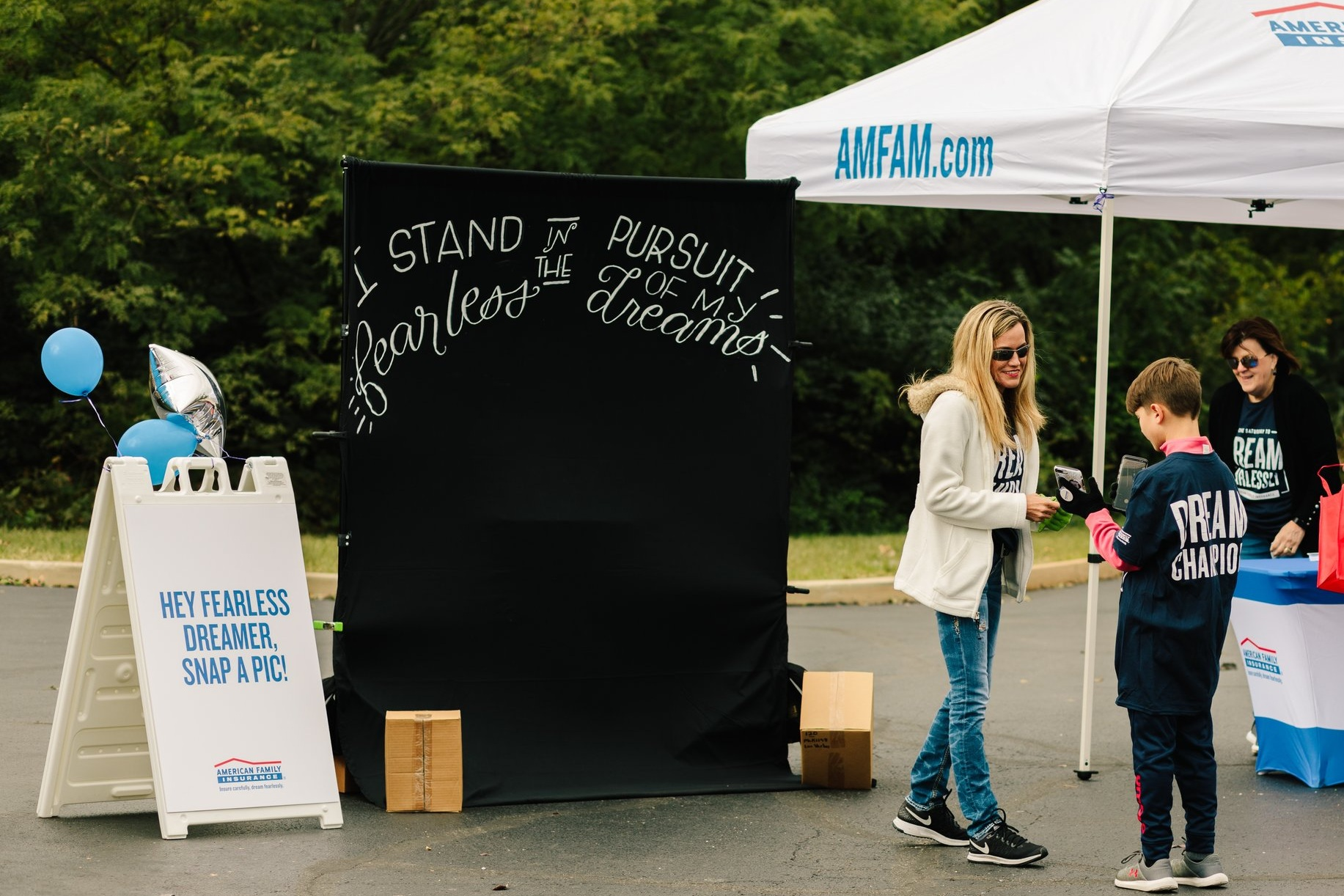 experential event lettering - A hand-lettered photo backdrop for American Family Insurance Dream Fearlessly event.