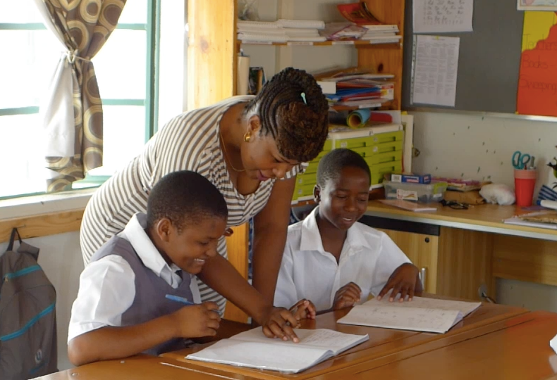 Madame Esther preps two students for their 7th form exams.