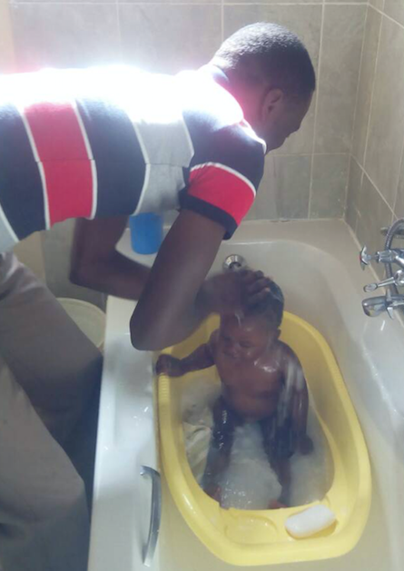 Giving little M a bath