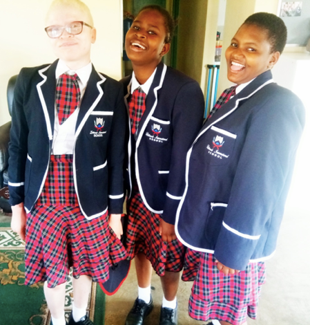 Viola, Johani and Dadisai share a laugh before heading out to their Job Shadow in their school uniforms.