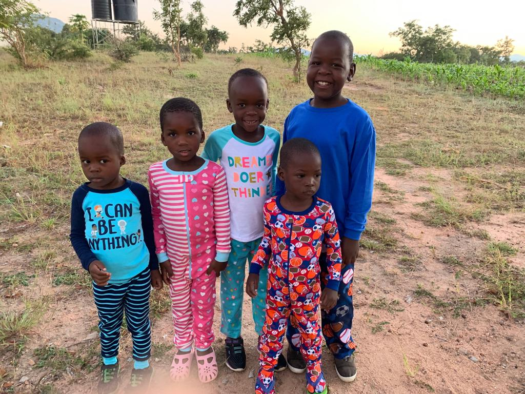 The sun is rising behind these sweet little ones in their new Easter jammies