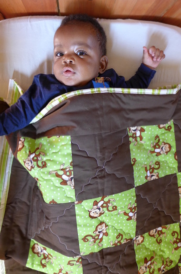 Baby in Quilt from Bellafina.png