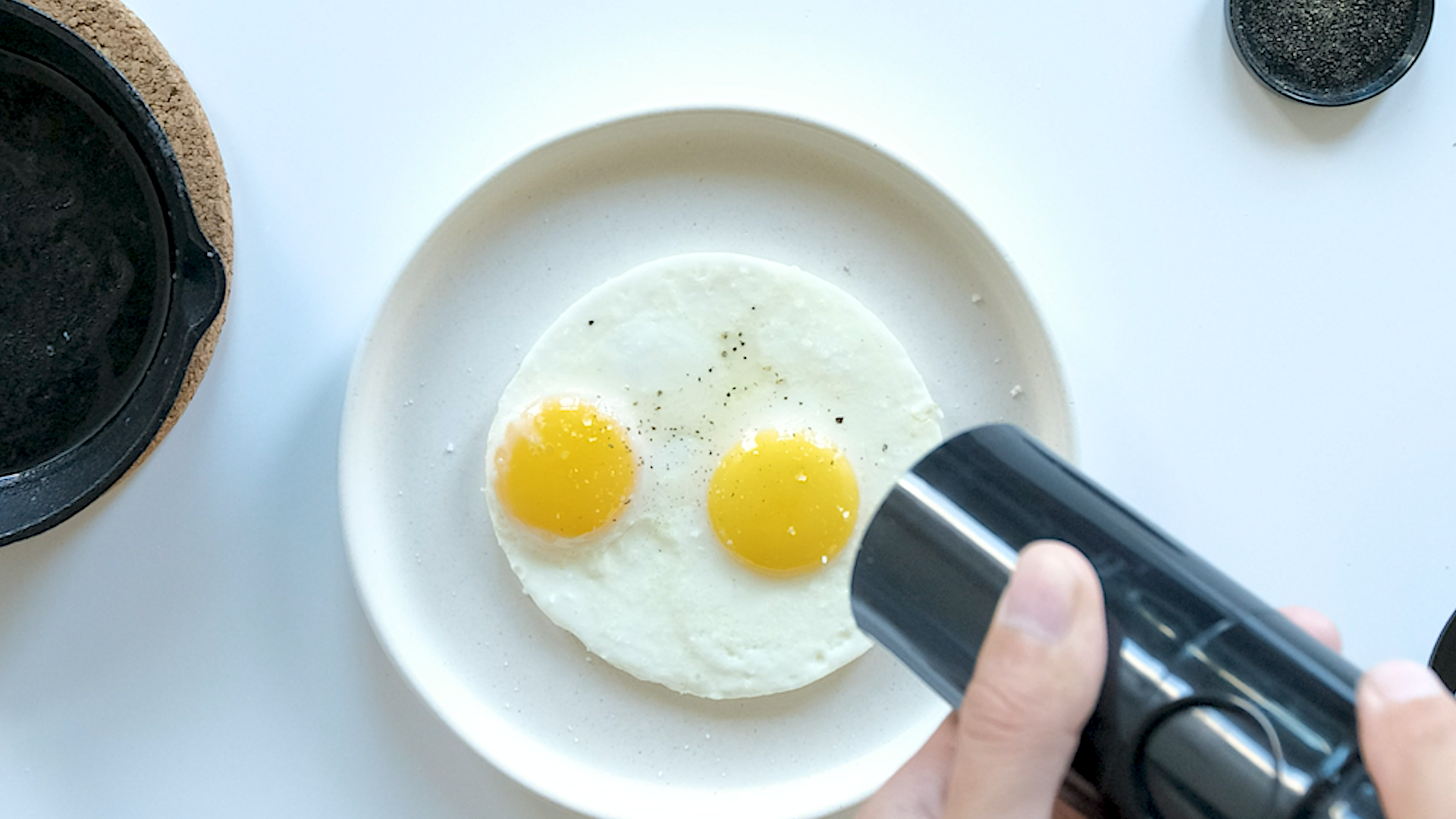 Fried eggs with salt and pepper.
