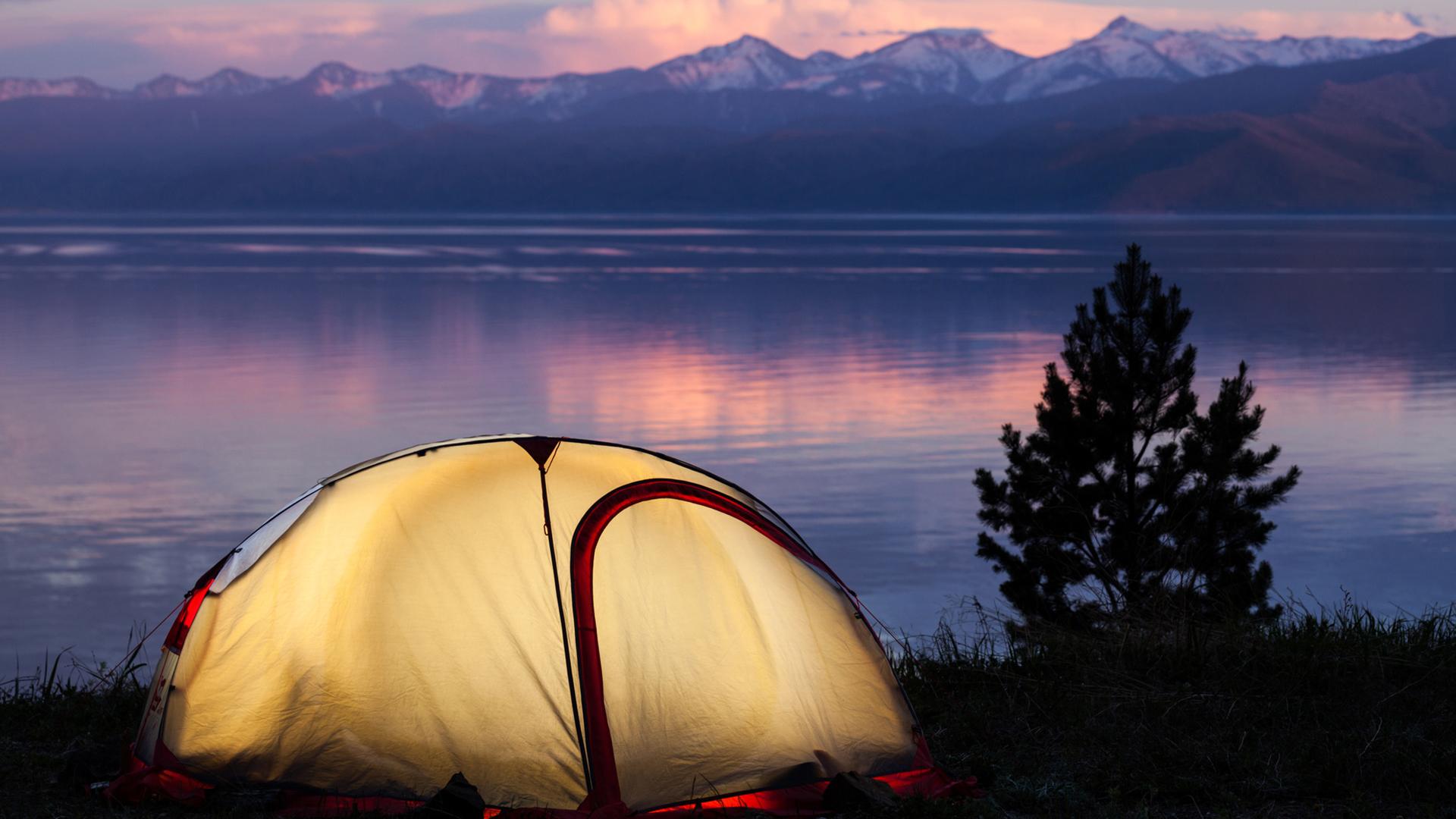 039076038-tent-across-beautiful-sunset-l.jpg