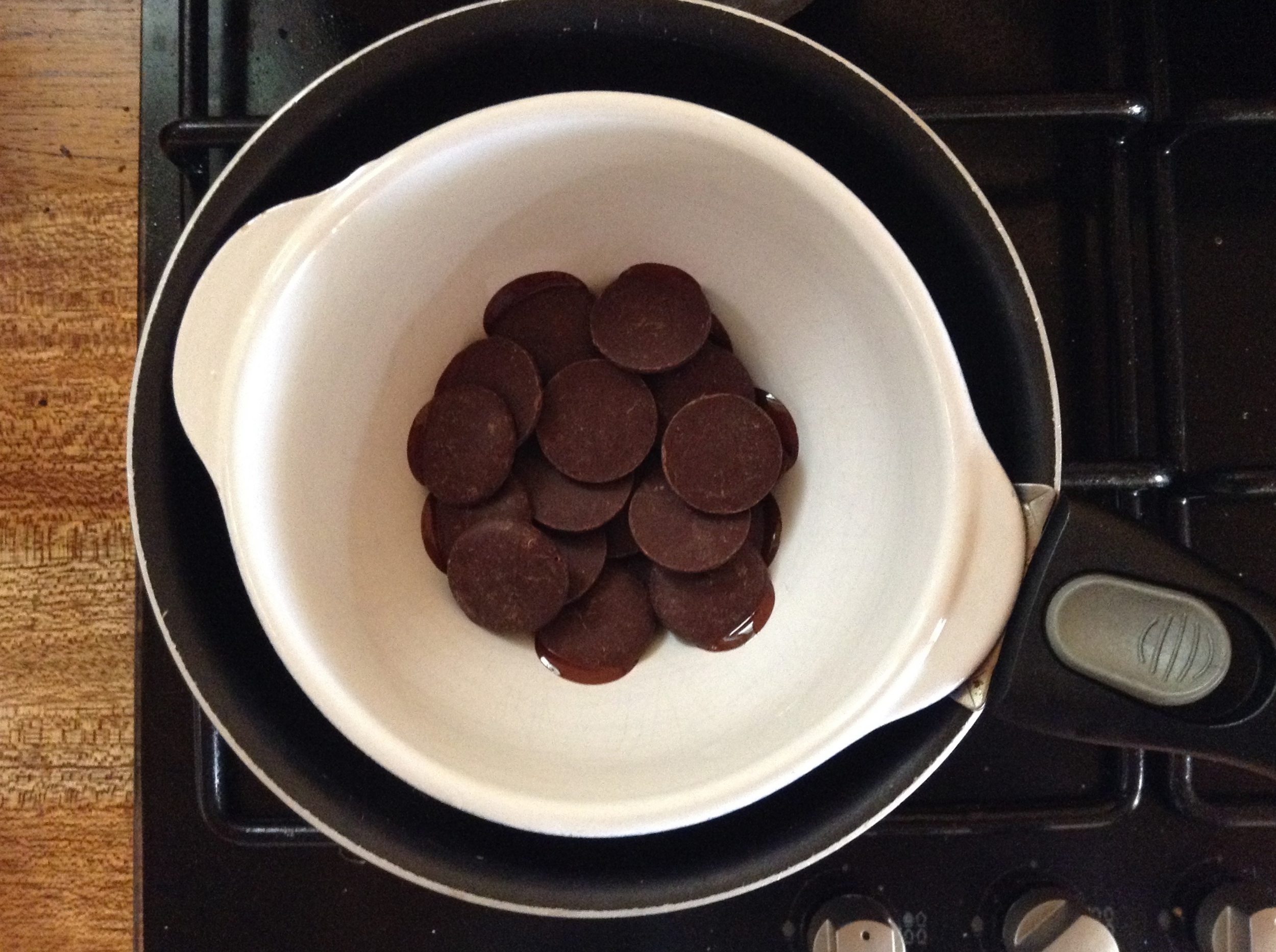 Melt the Cacao Paste Wafers in an improvised double boiler or a real one if you have it.  And congrats you, if you do. Otherwise, get crafty so you don't hurt your chocolate.