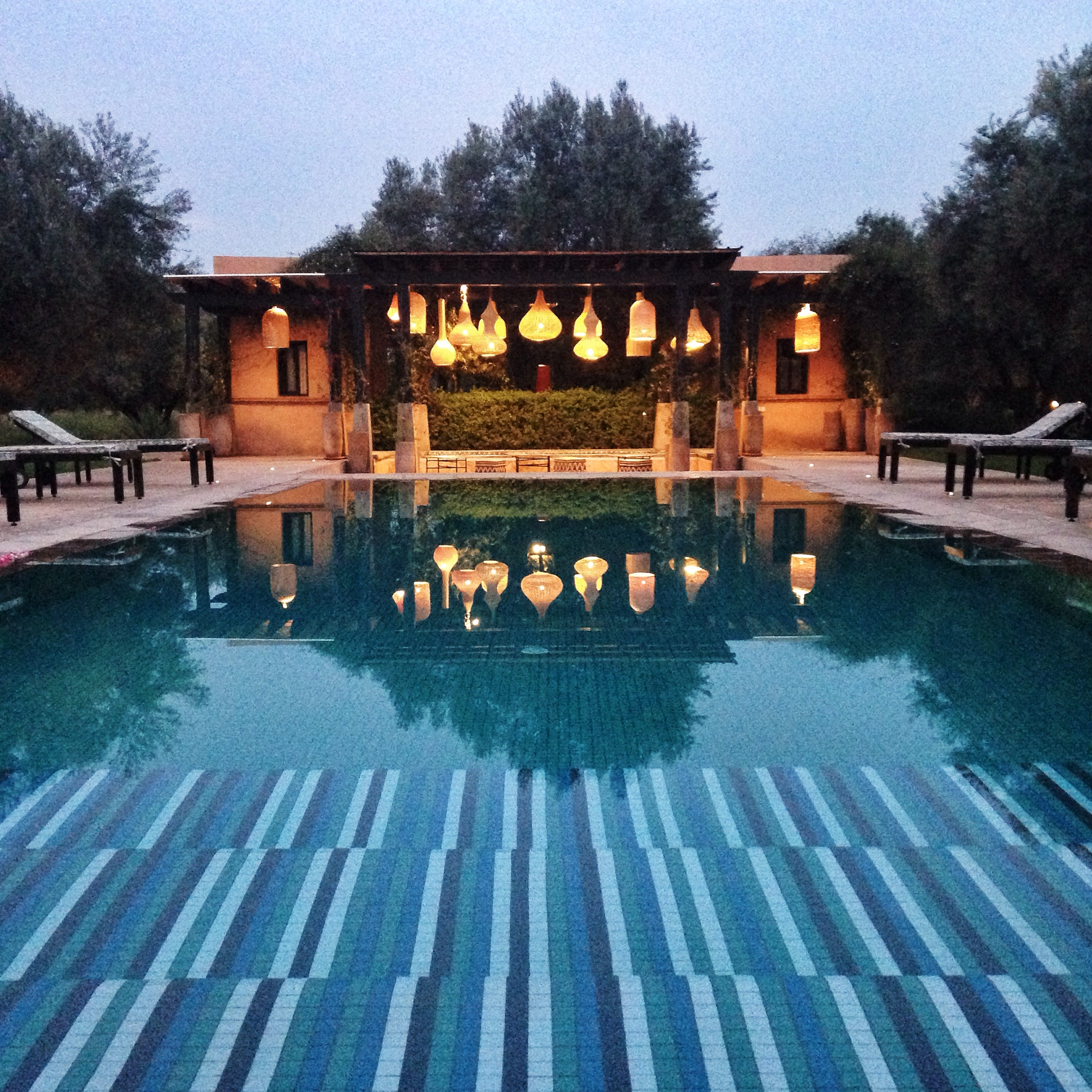 Evening Pool with Lanterns Peacock Pavilions  | EAT.PRAY.MOVE Yoga Retreat | Marrakesh, Morocco