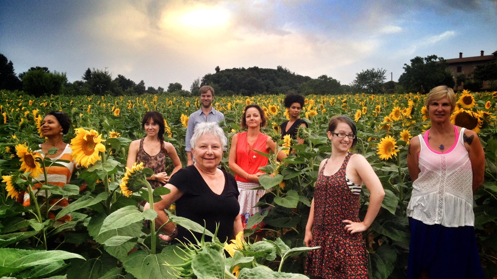 Guests in the sunflowers EAT.PRAY.MOVE Yoga Retreats | Tuscany, Italy