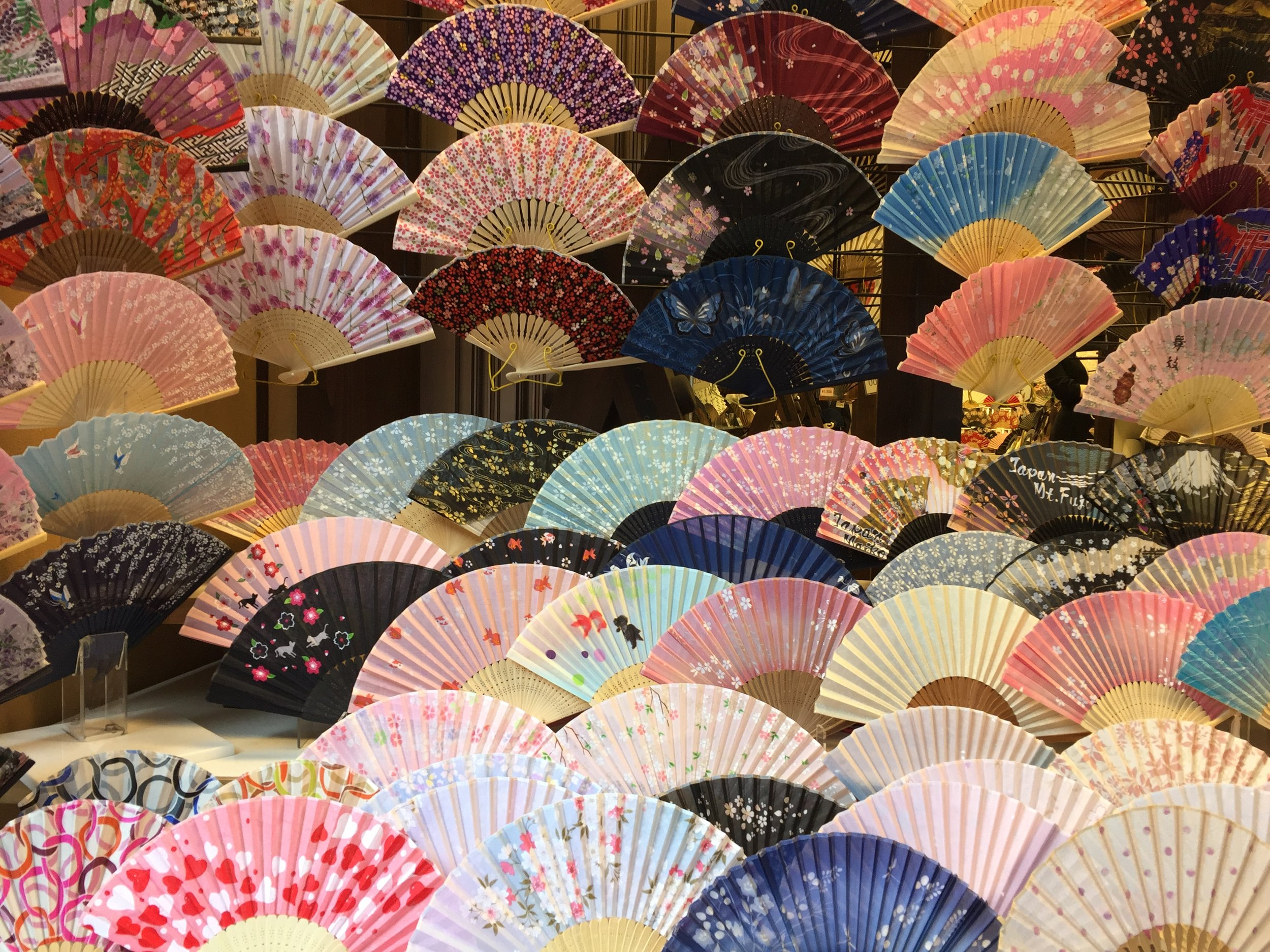 Colorful patterned fans  | EAT.PRAY.MOVE Yoga | Kyoto, Japan
