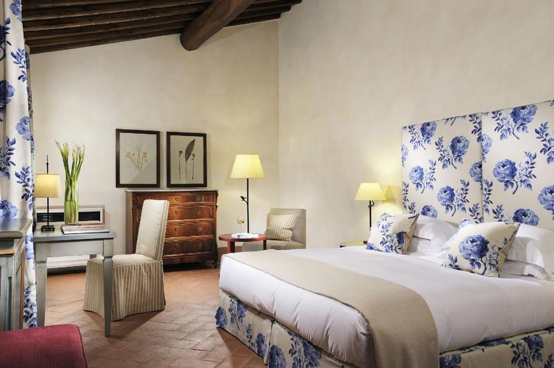 Wooden beamed bedroom Castello del Nero | EAT.PRAY.MOVE Yoga | Chianti, Italy