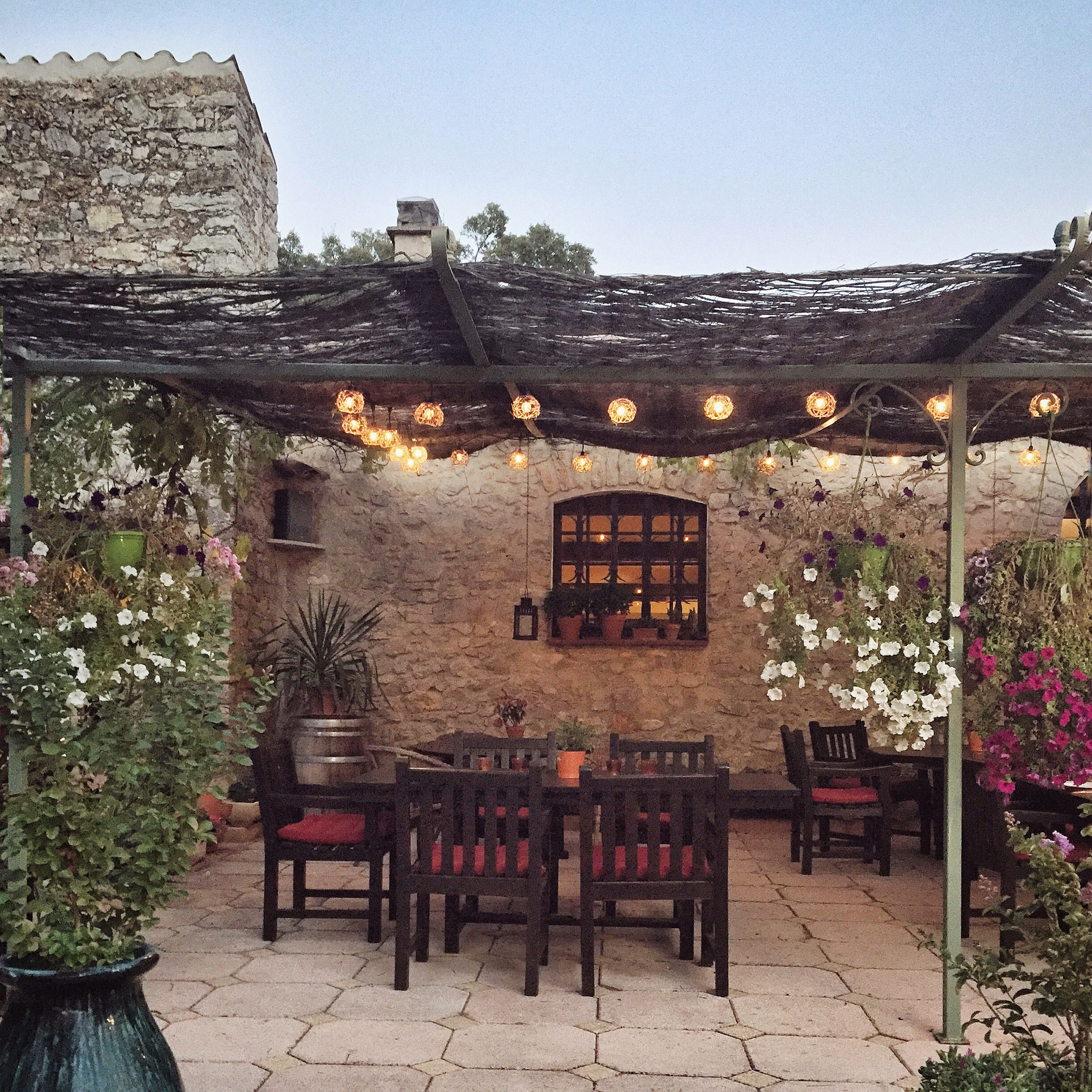 Dusk on the dining patio Bastide Avellanne | EAT.PRAY.MOVE Yoga Retreats | Provence, France