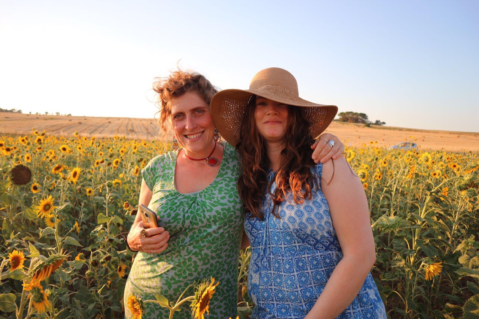 friends in the flowers | EAT.PRAY.MOVE Yoga Retreats | Tuscany, Italy