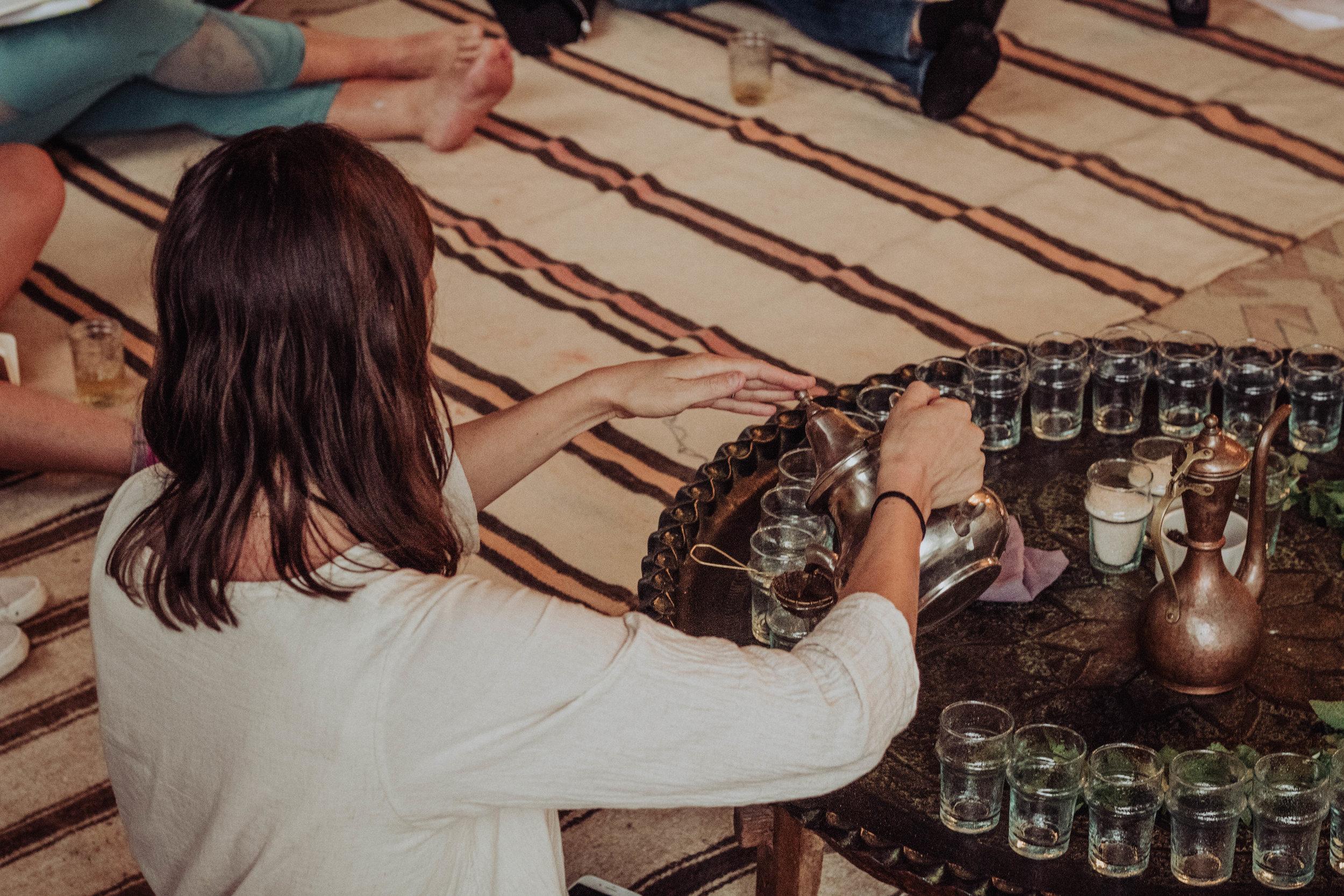 Sarah pouring Moroccan tea EAT.PRAY.MOVE Yoga Retreats | Marrakesh, Morocco