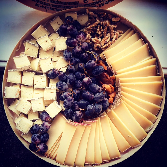 Hibiscus Dinners cheese plate: French, Italian or Norwegian cheese selection with nuts and jam.