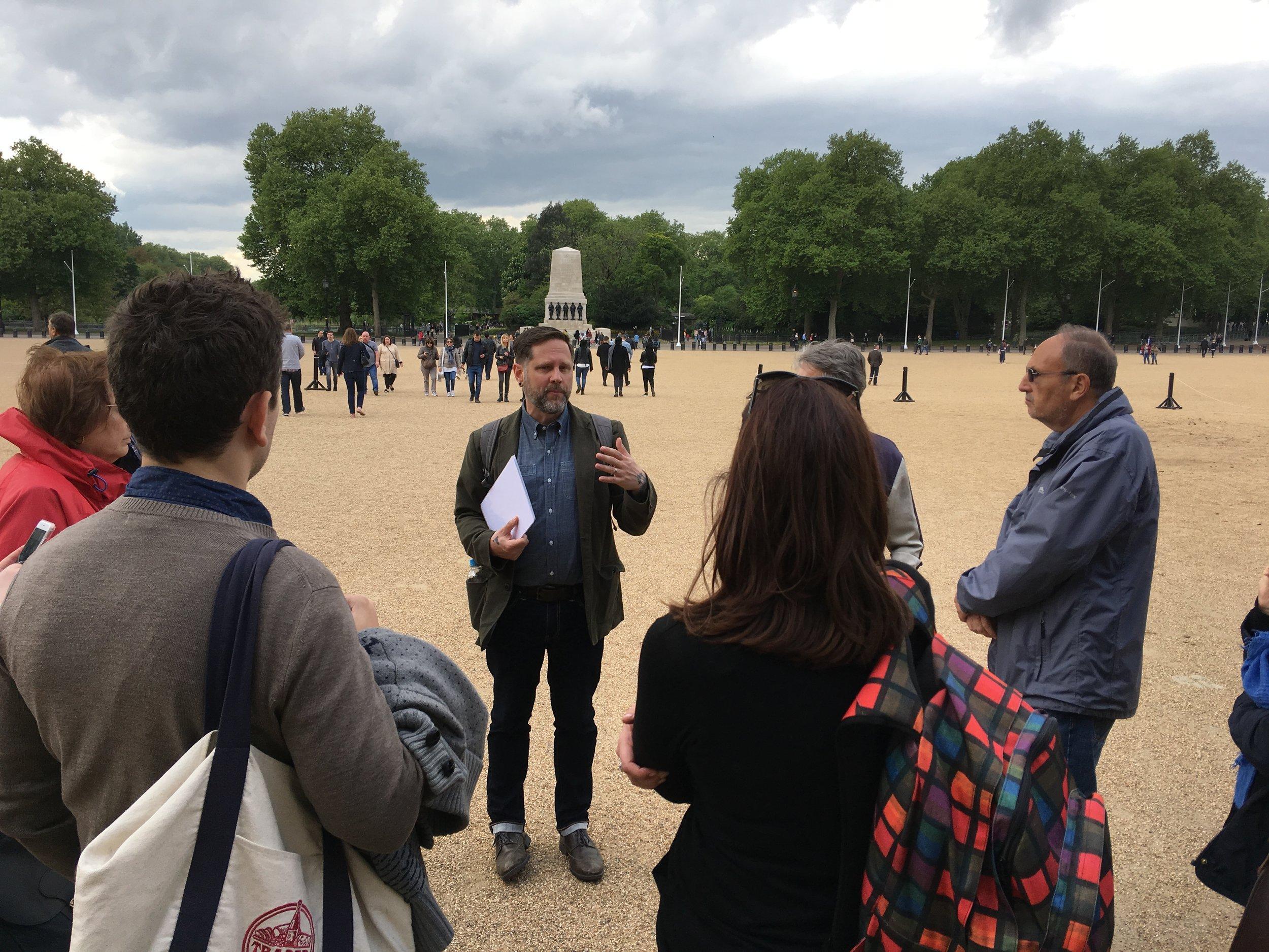 Professor Coll Thrush addresses a walking tour In London.