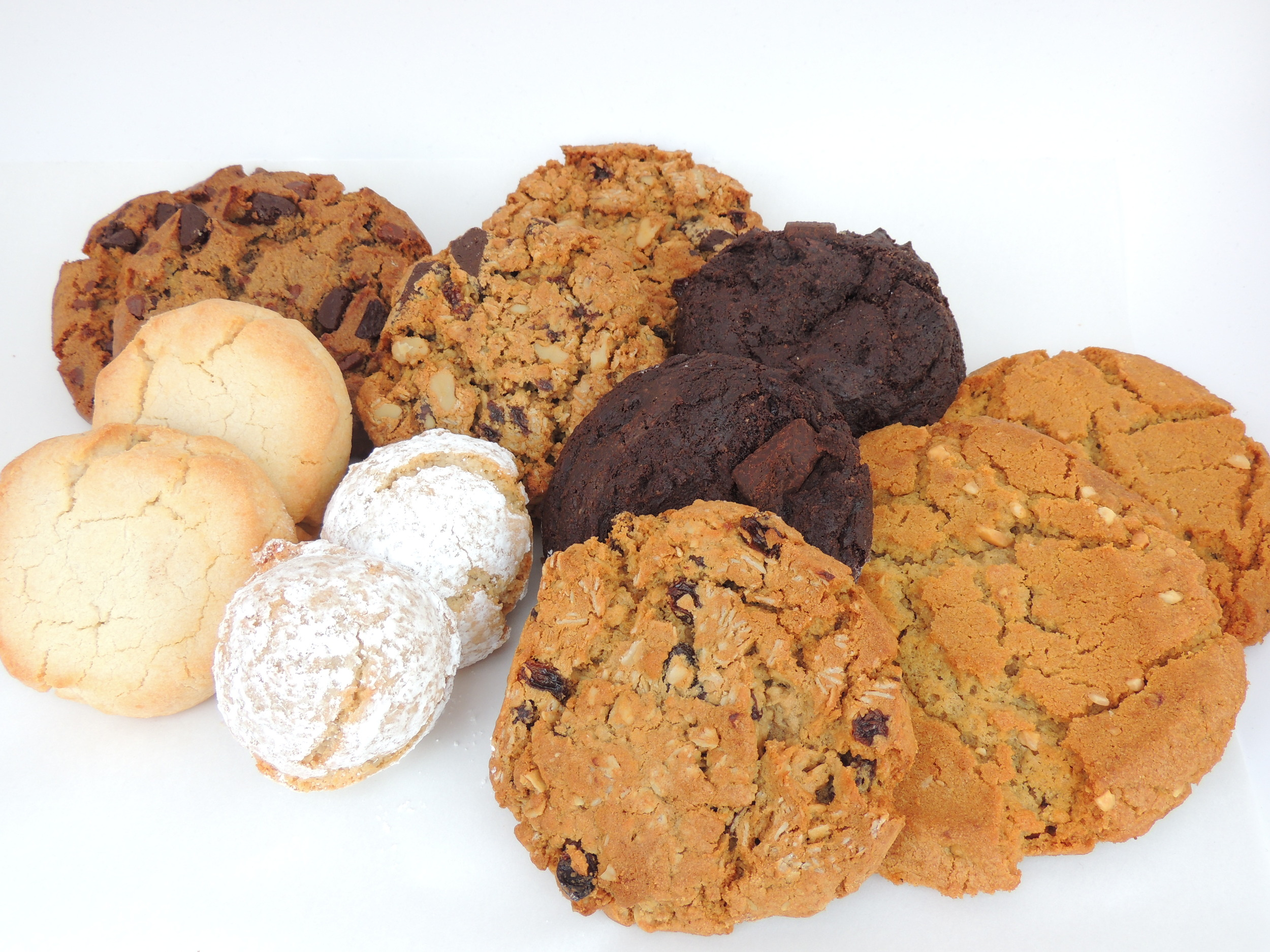 From left to right: Chocolate chip, shortbread, cowgirl, ricciarelli, double chocolate mint, oatmeal raisin, and peanut butter.