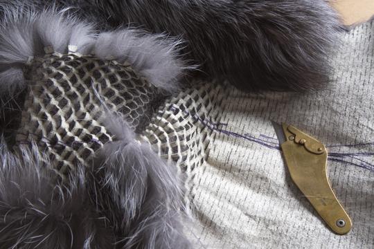 Perforating silver fox furs for custom coat. © Jonevon Furs, New York City. 212-714-0645