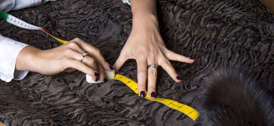 Altering a Swakara coat with natural sable collar. © Jonevon Furs, New York City. 212-714-0645