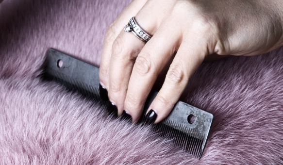 Combing pink dyed fox for custom coat. © Jonevon Furs, New York City. 212-714-0645