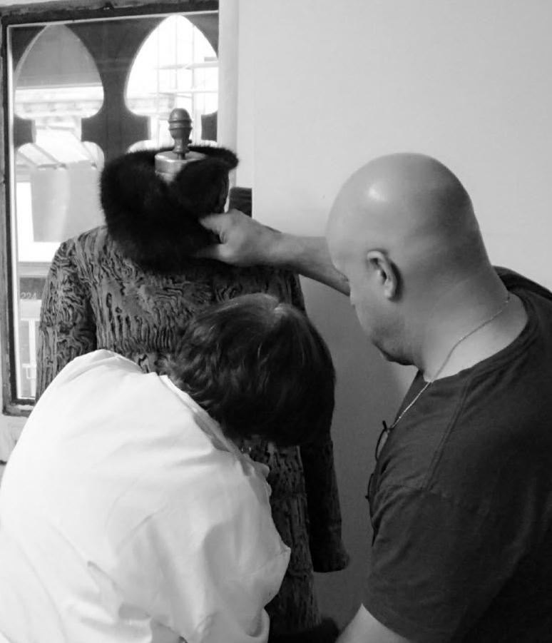 Aligning closures for proper fit for custom coat. © Jonevon Furs, New York City. 212-714-0645