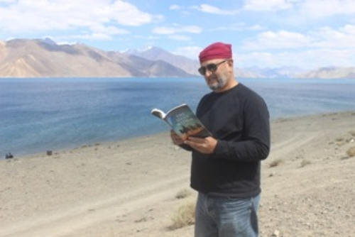 Bangong Lake @ 14,000 ft near the China border. An adventurer reads  The Oasis Within  for even more inspiration than the setting provides.