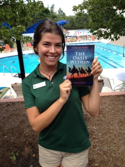Singer Caroline Klehr with  The Oasis Within , a bit of summer reading on a warm sunny day, poolside.