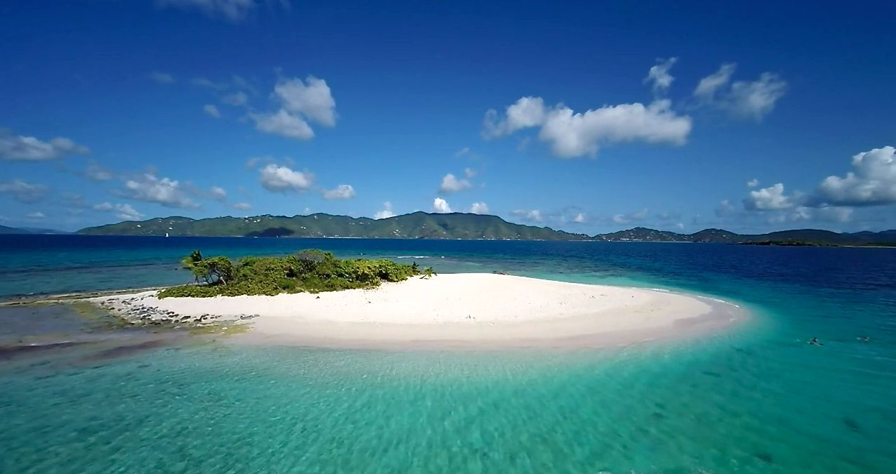 // Sandy Spit →<p>Straight out of a postcard, this uninhabited Cay delivers a moment away from it all.</p>