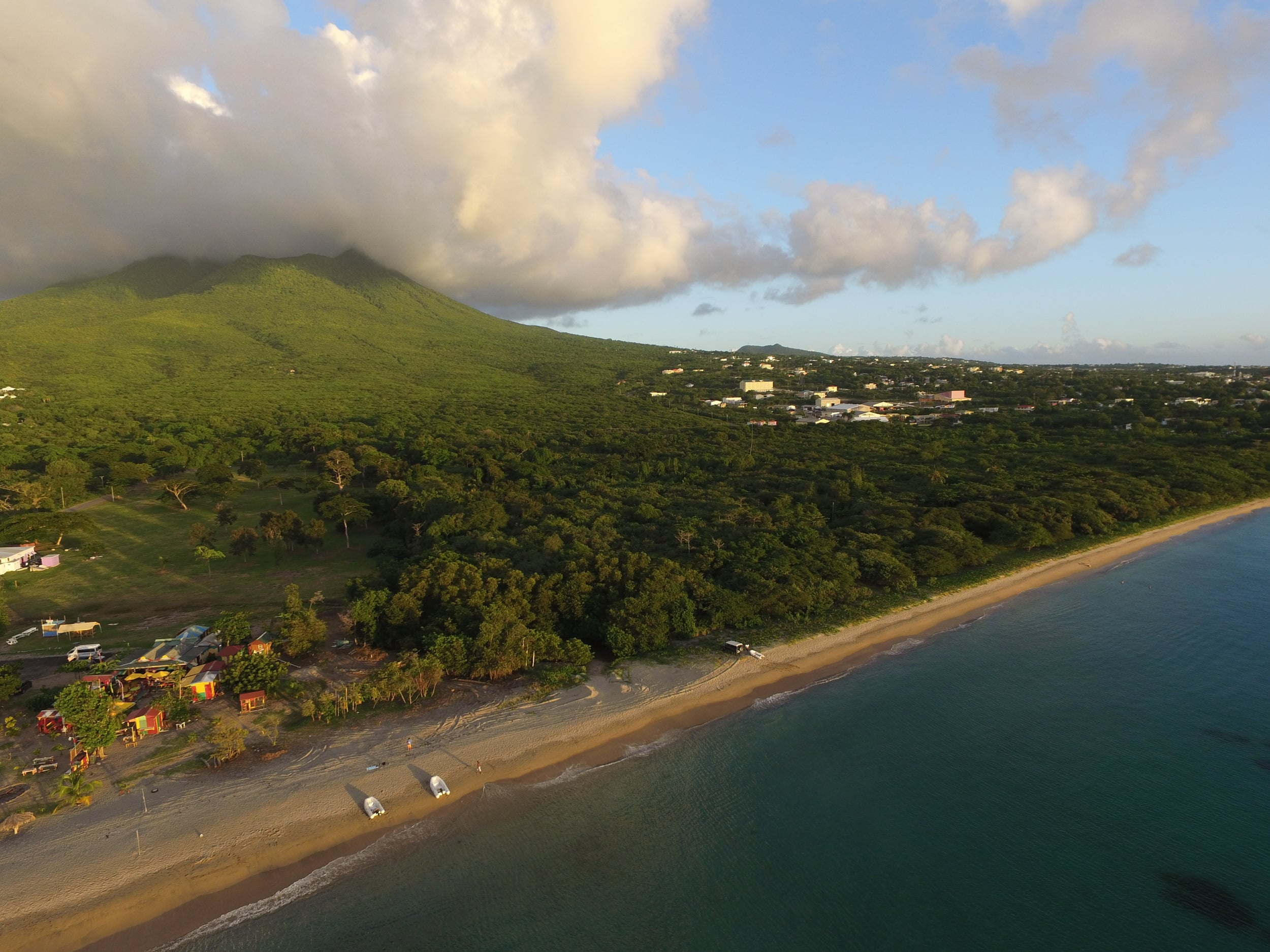 """// Nevis →<p>All that awaits us on Nevis is an empty beach, a bar called """"Sunshine's"""" and a Four Seasons hotel. Paradise defined.</p>"""