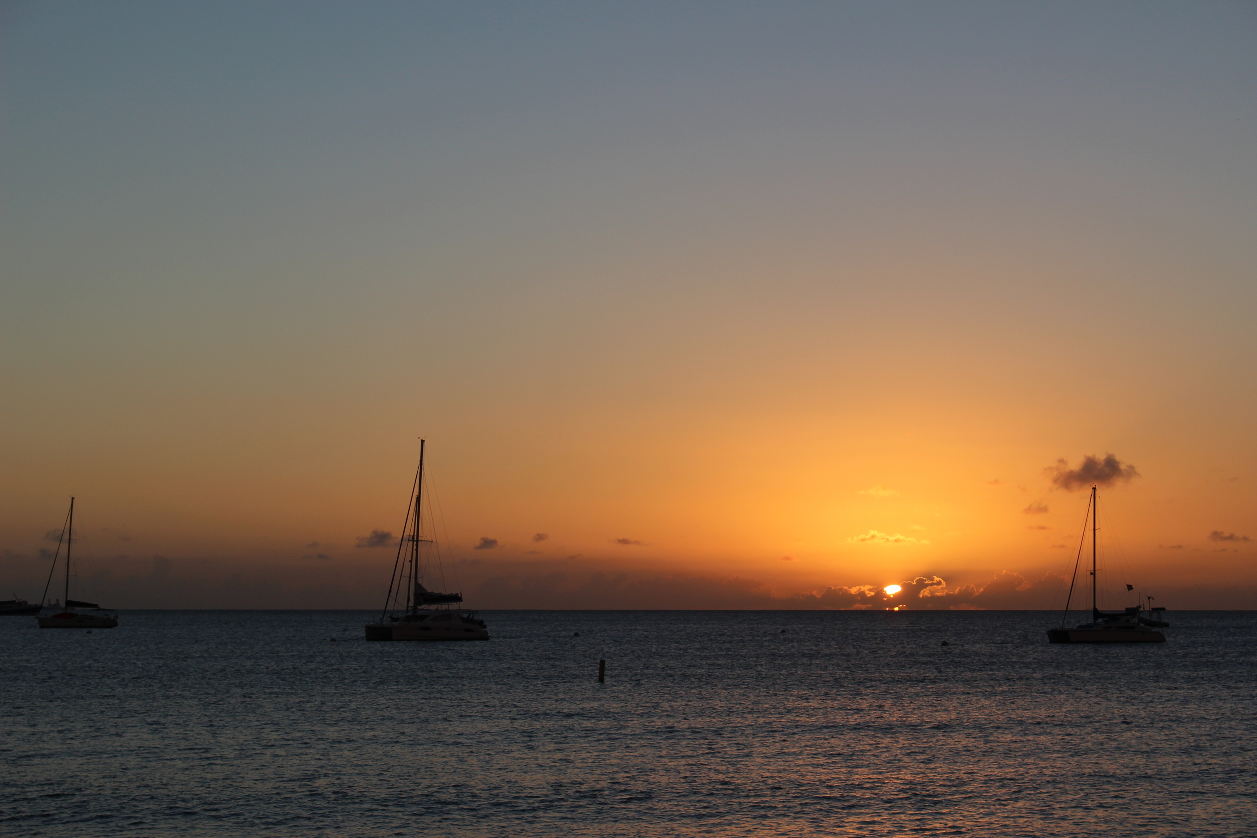 // Sunsets →<p>The sun literally melts into the Ocean down here. We choose to celebrate the occasion daily.</p>