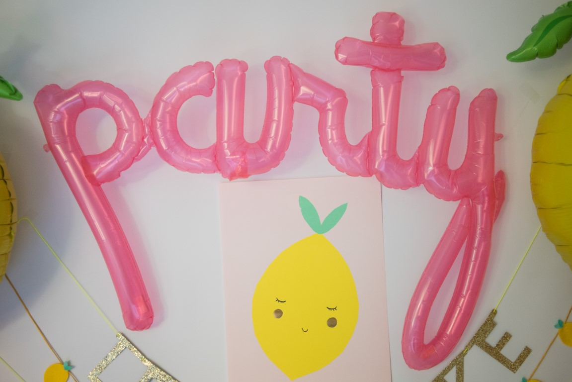 "Script Balloon Spells ""Party"" in Clear Pink"