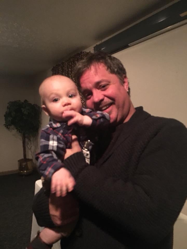 Karen's image of Dr. Waggoner and baby Arlo.jpg
