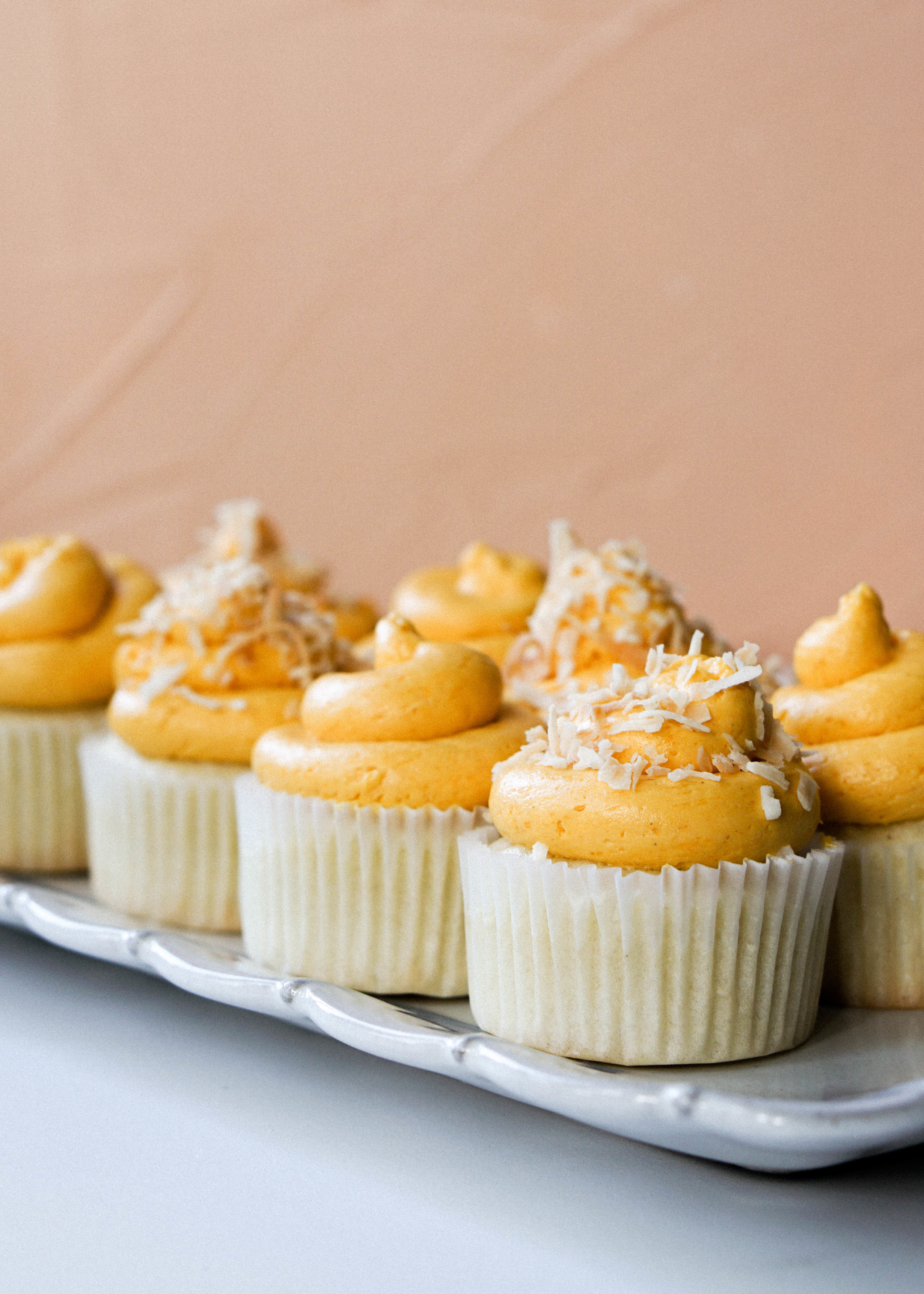 Coconut Cupcakes with Mango Buttercream
