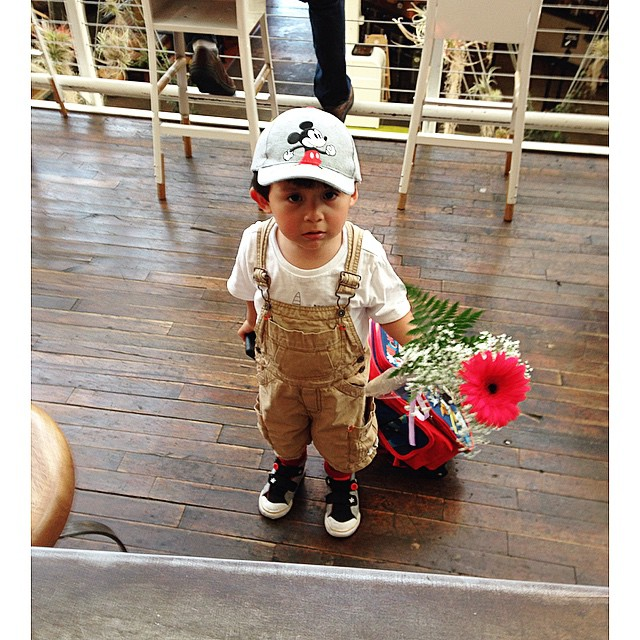 Special delivery. 💐 This little guy came by to give his mom, our manager, a flower for Mother's Day. So cute! ☺️ Happy Mother's Day to all the moms! #mothersday #mom #mother #cutie #cute #momandson #son #delivery #flowers #love #family #happy #packingdistrict #atthehouse #anaheimpackingdistrict #thechippy