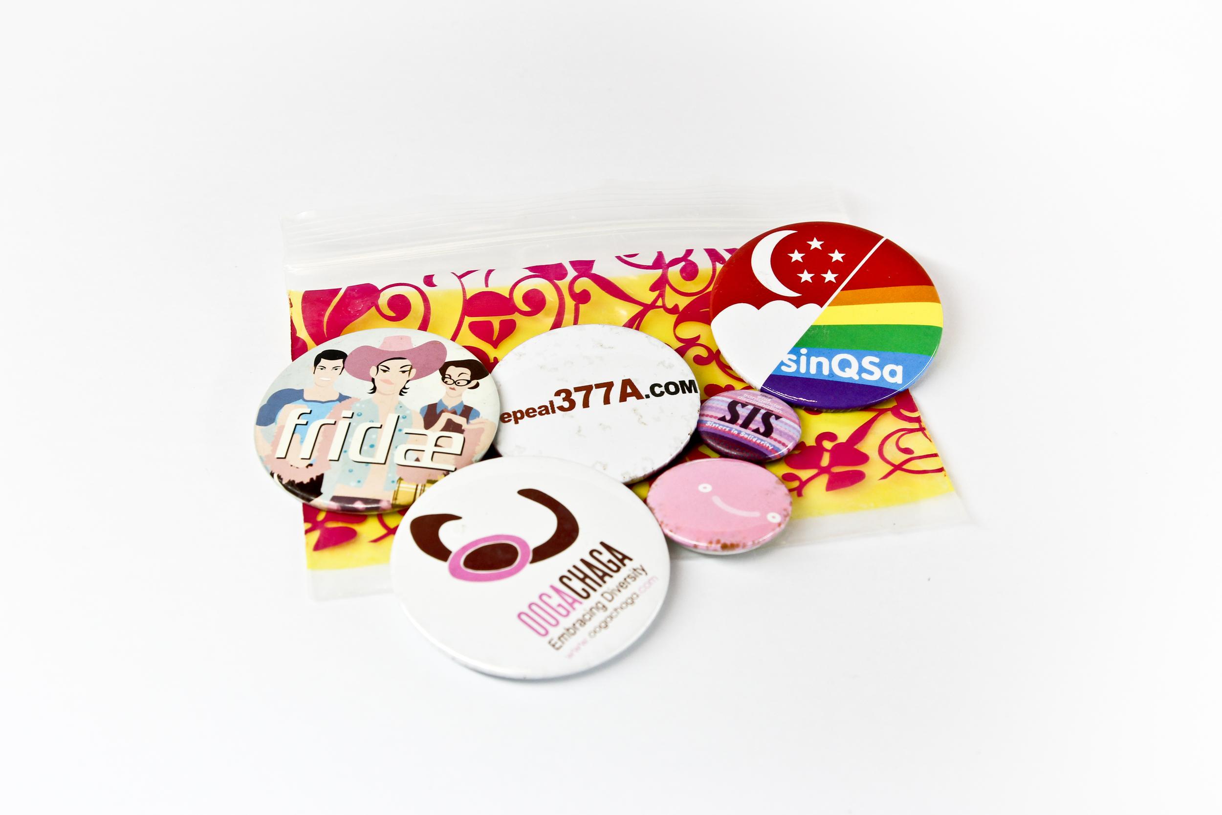 Six button badges