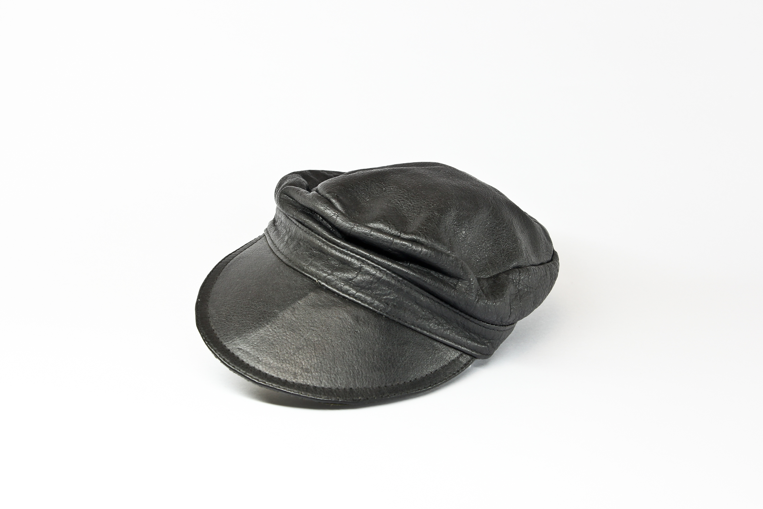 'Lecture, This Way' (installation) leather cap