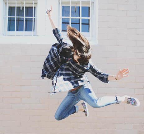 Owner Jonnie Estes jumping in air