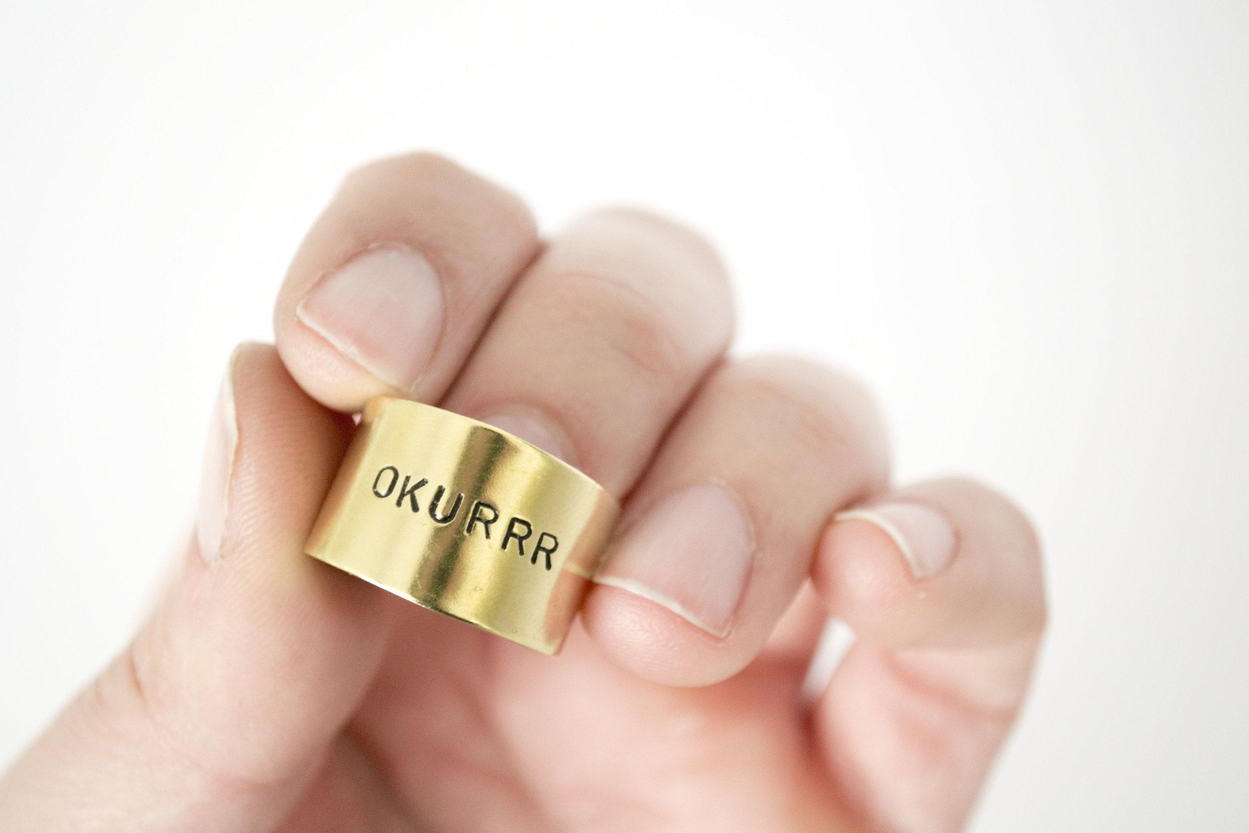 Stamped ring that reads, OKURRR
