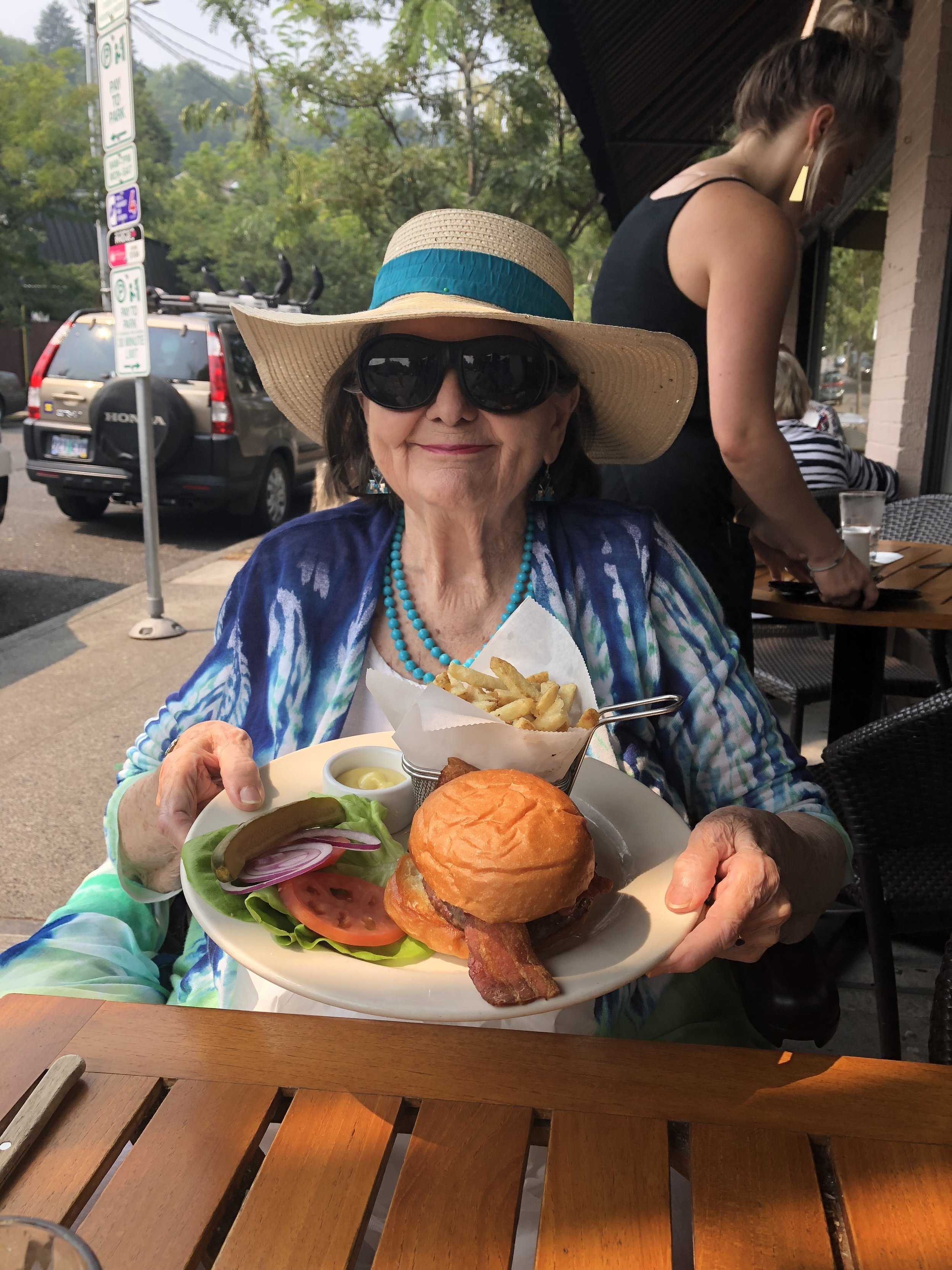 My 90-year-old friend Dolly, eating a burger that is not a Burger Week Burger.