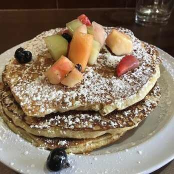 Fruit on your pancakes. Yes please.
