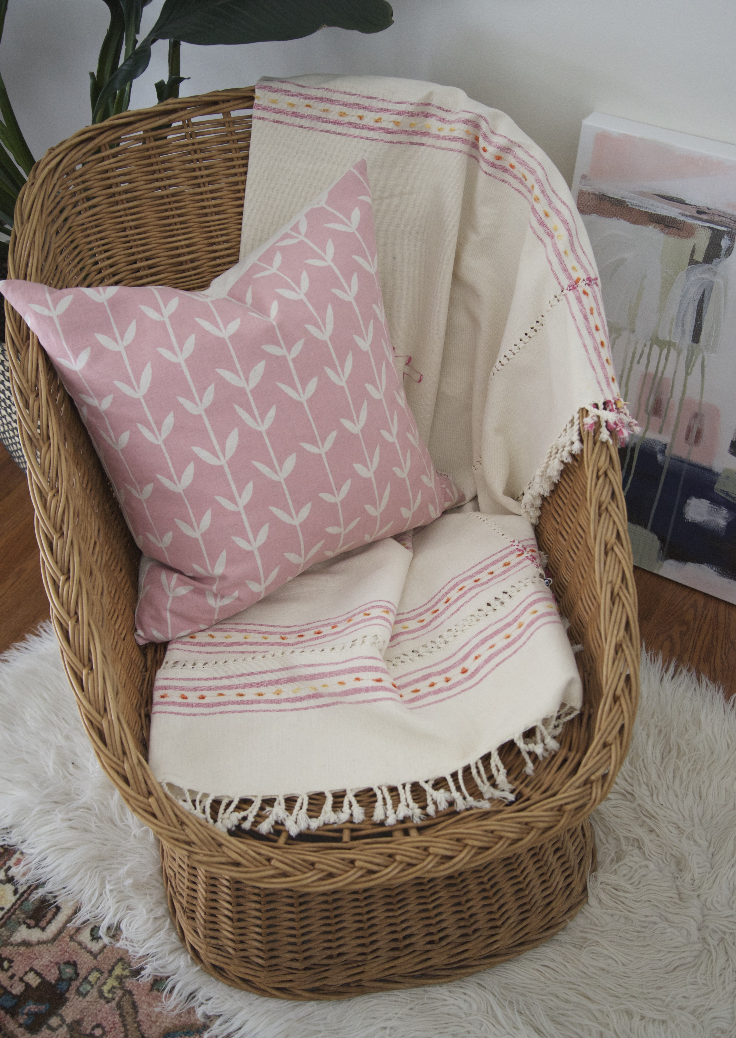 This rattan bucket chair is versatile indoors or out.