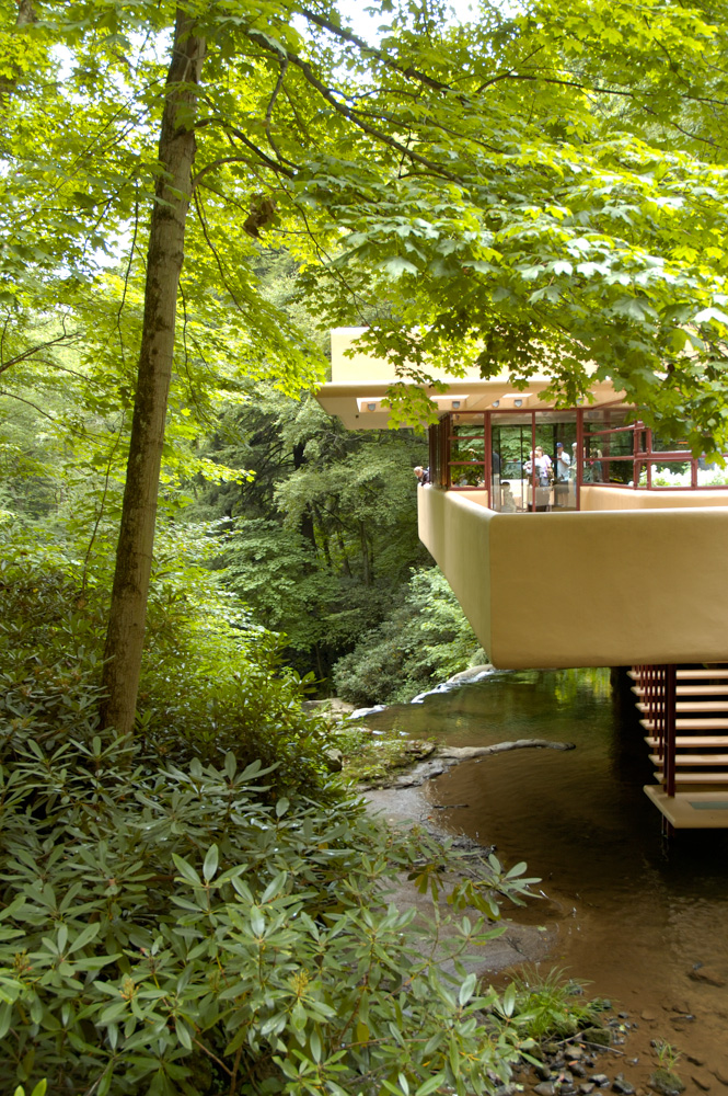 The home was built around the waterfall, I can't even imagine living here it is so stunning!