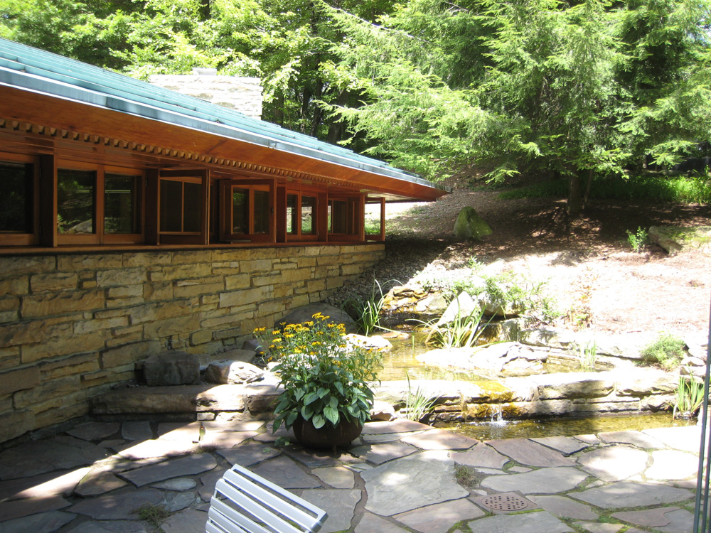 The windows open to the pond & wonderful patio filled with sculptures.
