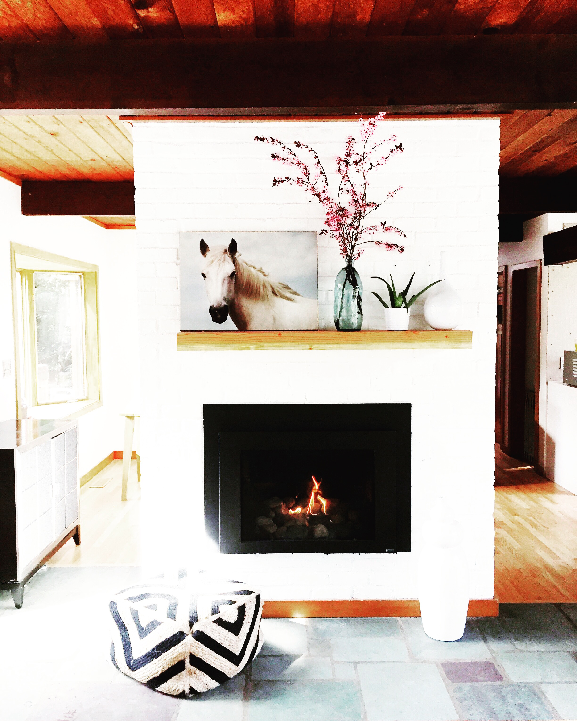For $20 Audrey purchased this 4x8 piece of Douglas Fir from a local Lumbar Yard & created this simple mantle.