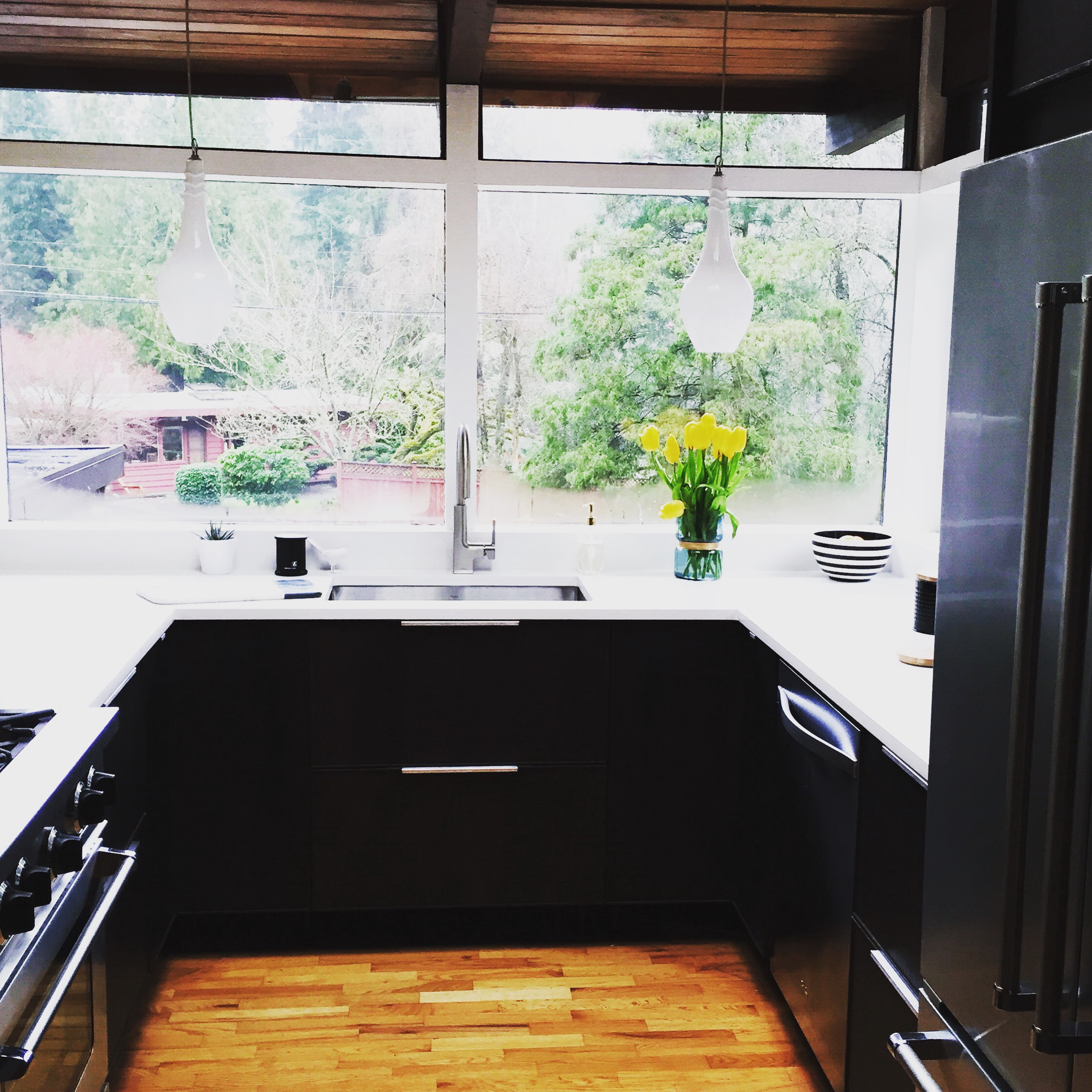 This area of the kitchen has already been renovated. Don't we all wish we could look out those stunning windows while we did the dishes.